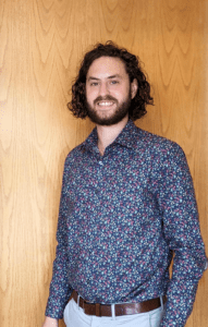 Headshot of new senior marketing coordinator/proposal manager Colin Corna