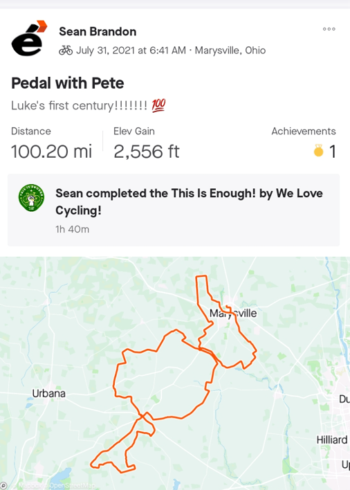 """A screenshot from a mobile app that depicts a map of a bike ride. Text reads """"Pedal with Pete,"""" """"Luke's first century!,"""" """"Distance: 100.20 mi,"""" """"Elev Gain: 2,556 feet,"""" and the caption """"Sean completed the This Is Enough! by We Love Cycling! 1h 40m"""""""